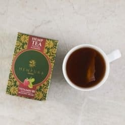 Hempura Hemp Tea Natural Raspberry from above with cup